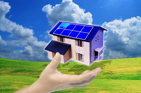 residential market: hand hold solar power house or home Stock Photo