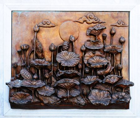 Ancient art of wood carving of Thai temple in Bangkok, Thailand.