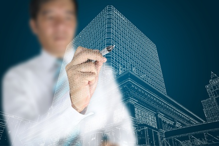 Businessman draw modern building and cityscape photo