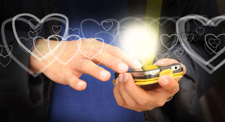 dialing: Hand of business man send heart on mobile phone as Valentine concept Stock Photo