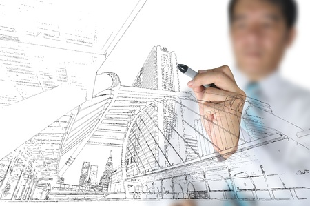 house sketch: Hand of business man draw building and cityscape