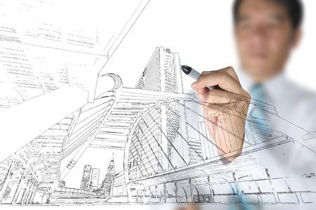 arquitecto: Mano de hombre de negocios dibujar edificio y el paisaje urbano Foto de archivo