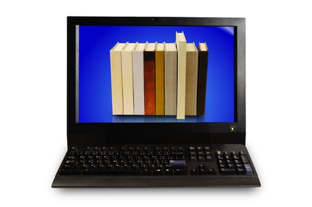 Stack of book in display of Desktop computer set photo