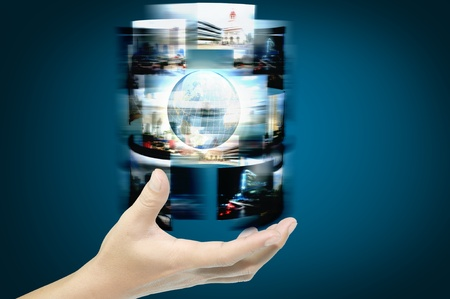 computer user: Hand of businessman hold streaming images with earth globe