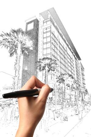 arquitecto: Mano masculina edificio de dibujo y el paisaje urbano como el plan de arquitecto Foto de archivo
