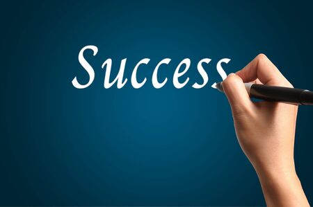 Male Hand Write the Word Success photo