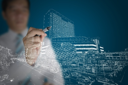 Business man draw modern building and cityscape