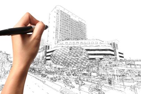 bocetos de personas: Mano de hombre de negocios Dibuja un edificio moderno y el paisaje urbano Foto de archivo