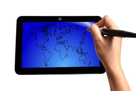 Hand of Business Man Draw World Map on Touch screen of Tablet PC photo