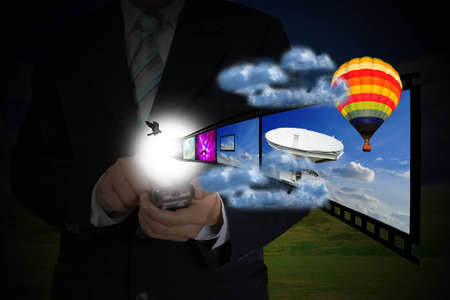Hand of Business Man Pushing touching screen of mobile smart phone as Media Technology concept photo