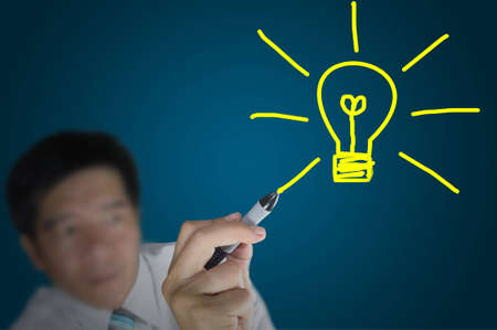 Hand of business man write a light bulb on tablet pc touch screen Stock Photo - 12802612