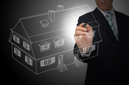 Business Man Drawing house or estate as real estate concept photo