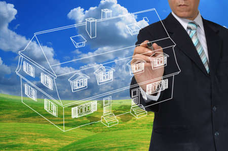 Business Man Drawing house or estate as real estate concept Stock Photo - 12465353