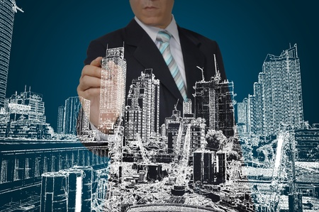 housing development: Business Man Drawing building and seascape Stock Photo