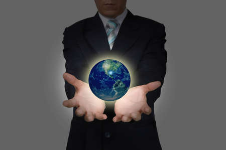 Hand of Business Man hold earth globe   photo