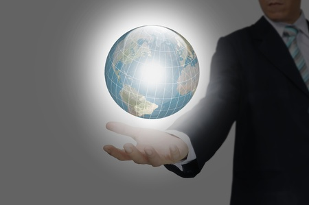 world of work: Hand of Business Man hold earth globe