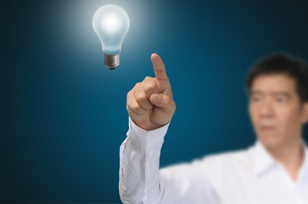 Business Man touch light bulb Stock Photo - 12919614