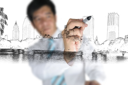 Business Man Drawing cityscape photo