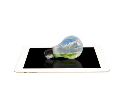 electric power station: Light bulb with turbine power generator on white tablet PC Stock Photo