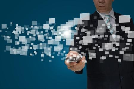Hand of Business Man Hold touch screen of smartphone sending digital data. Standard-Bild