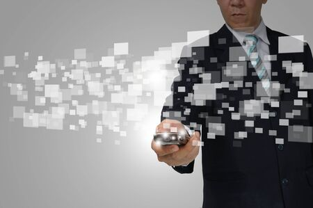 Hand of Business Man Hold touch screen of smartphone sending digital data. Stock Photo - 13215461