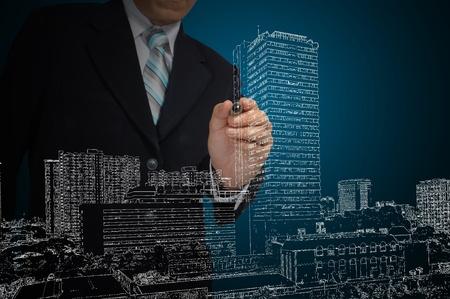 trekken: Hand van Business Man gelijkspel stadsbeeld Stockfoto