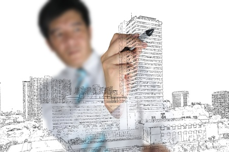 Hand of Business Man draw cityscape. Stock Photo