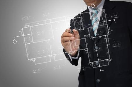 Hand of Business Man Draw architect or home plan Zdjęcie Seryjne - 13423208