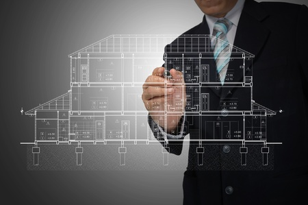 Hand of Business Man Draw architect or home plan photo