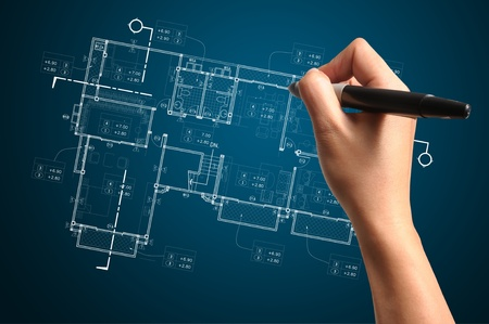 architecture plans: Hand of Business Man Draw architect or home plan