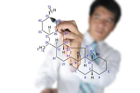 Male Teacher write science formula on white background photo