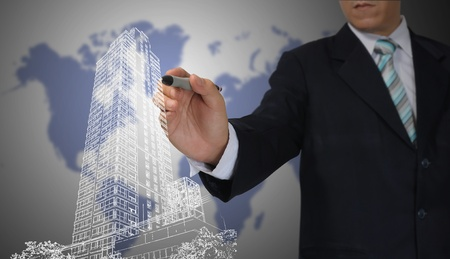 Business Man or Architect draw cityscape photo
