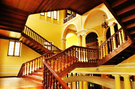 balustrade: Wooden staircase in ancient building  Stock Photo