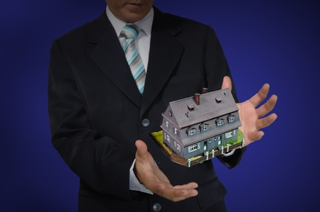 Business Man holding house or home Stock Photo - 14402306