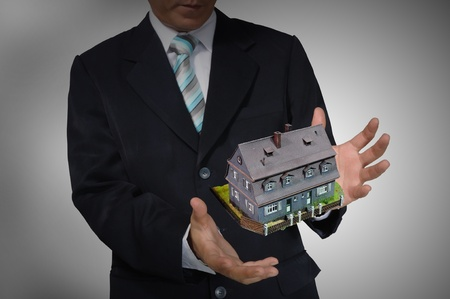 Business Man holding house or home Stock Photo - 14402307