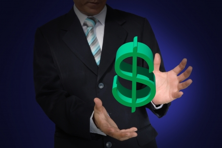 Hand of business Man holding Dollar symbol photo
