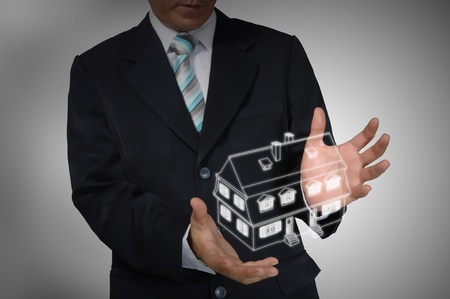 Business Man holding house or home Stock Photo - 14402299