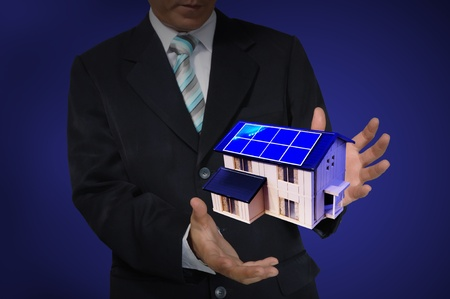 Business Man holding house or home Stock Photo - 14402296