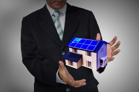 Business Man holding house or home photo