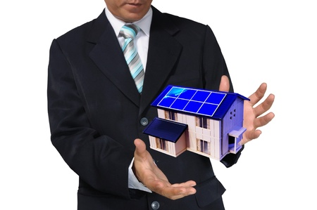 Business Man holding house or home Stock Photo - 14402298
