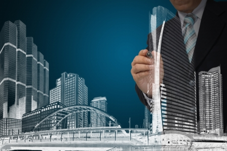 Business Man or Architect draw cityscape and building photo