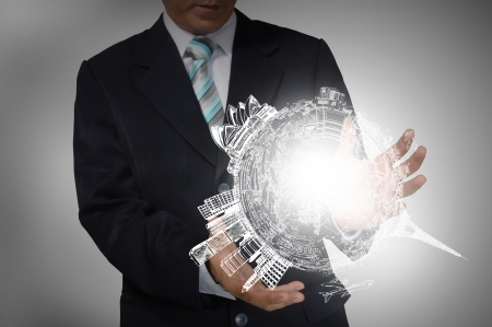 Business Man holding drawing earth globe photo