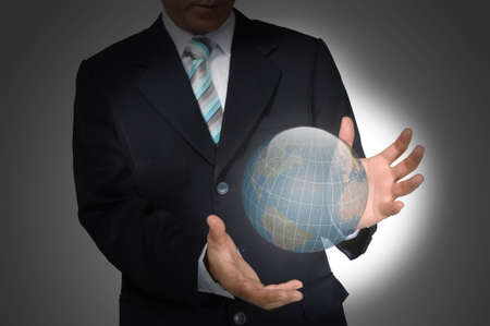 Business Man holding earth globe  Elements of this image furnished by NASA photo