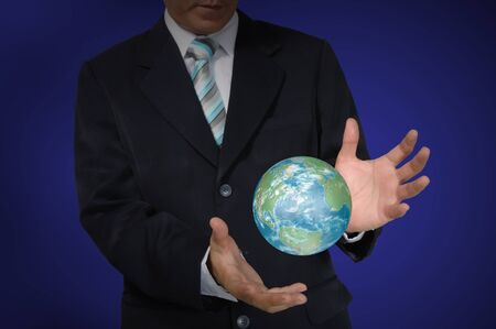 Business Man holding earth globe  photo