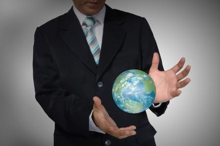 Business Man holding earth globe  photo