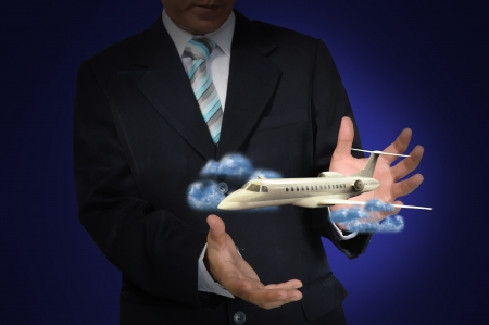 Airplane in the hand of business man photo
