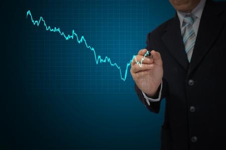 Business Man write graph photo