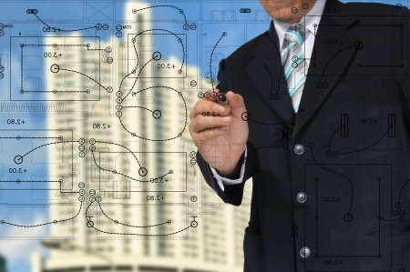 engineering drawing: Hand of Business Man Draw architect or home with electrical plan