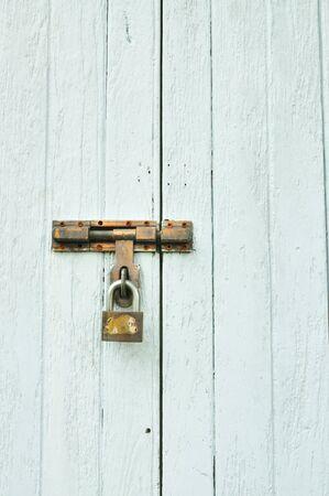 green door: Locked door with key Stock Photo