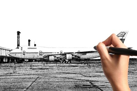 Male Hand drawing airplane at the airport photo